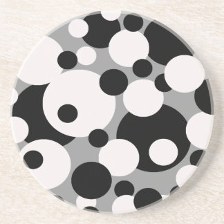 Black and white circles on silver coasters
