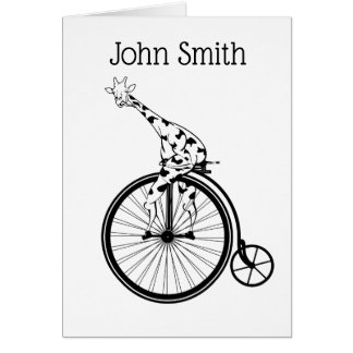 Black and white giraffe riding a bike card
