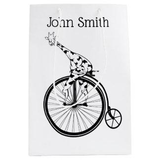 Black and white giraffe riding a bike medium gift bag