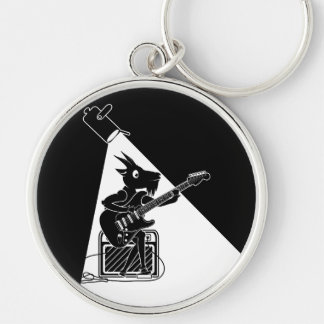 Black and white goat playing an electric guitar key ring