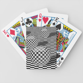 Black and white illustration with balls on a chess bicycle playing cards