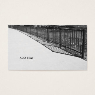 black and white image of a black fence business card