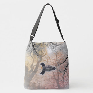 Black and white loon on a lake Cross Bag abstract
