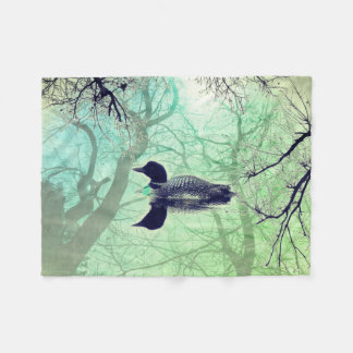 Black and white loon on a lake throw blanket green