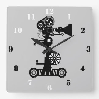 BLACK AND WHITE MOVIE CAMERA WITH NUMERALS SQUARE WALL CLOCK