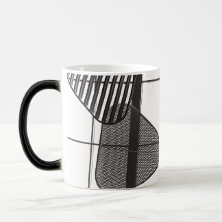 Black and white mug with metal shapes