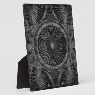 Black and white music speakers plaque
