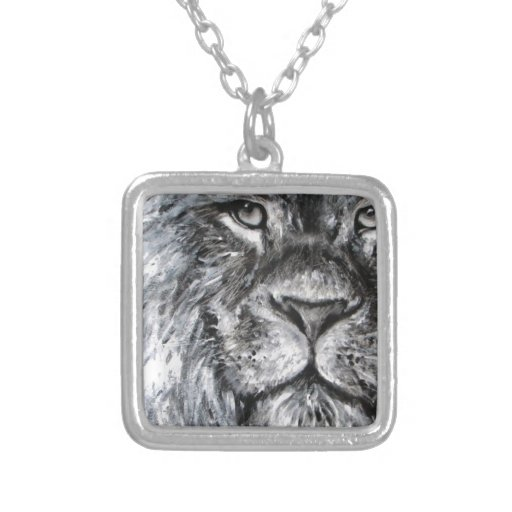 Black and white painting of a lion in nature jewelry