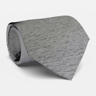black and white rafts on river scenery tie