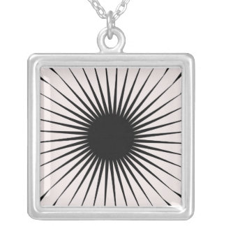 Black and white starburst design silver plated necklace