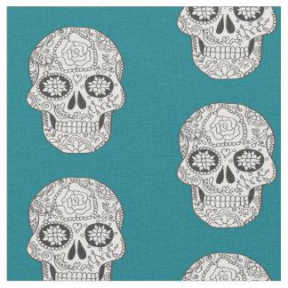 Black and white Sugar Skulls on teal fabric