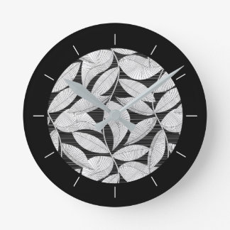 Black and white tropical leaf round clock