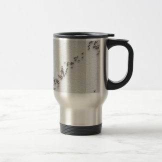 Black ants are following each other in a chain travel mug