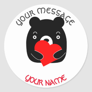 Black bear holding a heart classic round sticker