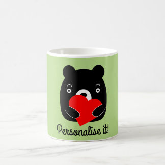 Black bear holding a heart coffee mug