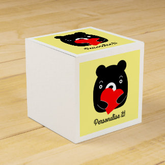 Black bear holding a heart favour box