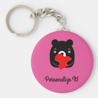 Black bear holding a heart key ring