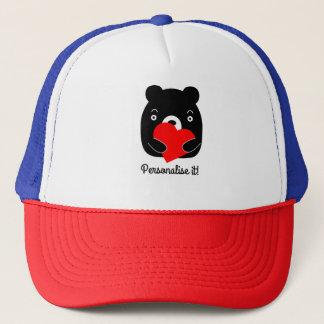 Black bear holding a heart trucker hat