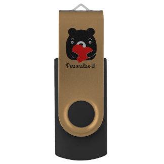 Black bear holding a heart USB flash drive