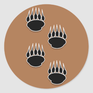 Black Bear Paw Prints On Earth Tone Background Round Stickers
