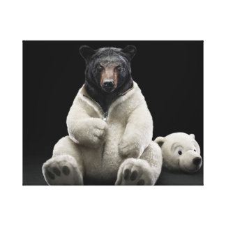 Black bear wearing polar bear costume stretched canvas prints