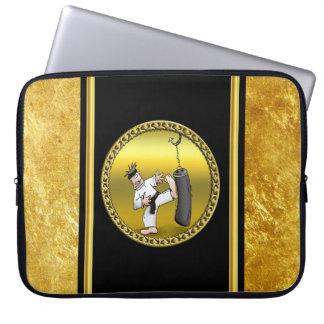 Black belt karate man kicking a black training bag