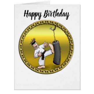 Black belt karate man kicking a black training bag card