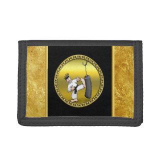 Black belt karate man kicking a black training bag tri-fold wallets