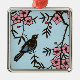 Black Bird in Pink Cherry Blossom Tree on Blue Metal Ornament