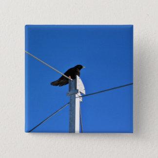 Black bird on a post 15 cm square badge