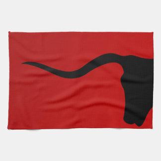 Black bull on red tea towel