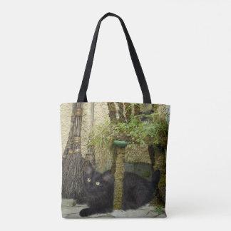 Black cat and broomstick tote bag