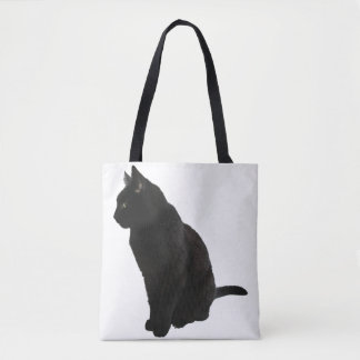 Black cat looking aside tote bag