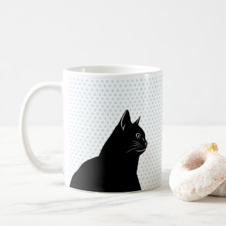 Black cat on polka dots background coffee mug