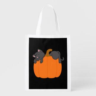 Black Cat Sleeping on Halloween Pumpkin Reusable Grocery Bag
