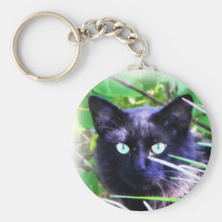 Black cat with striking green eyes key chain