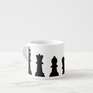 Black chess pieces on white espresso cup