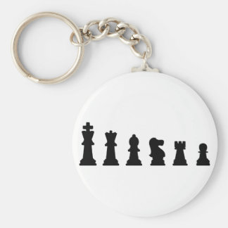 Black chess pieces on white key ring