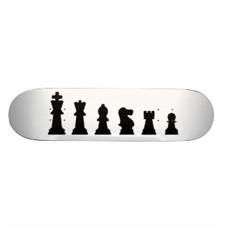 Black chess pieces on white skateboard deck