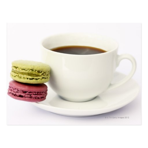 Black coffee in white cup with two french post card