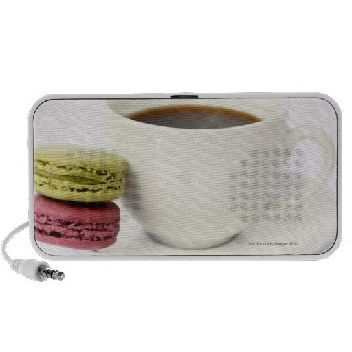 Black coffee in white cup with two french mini speakers