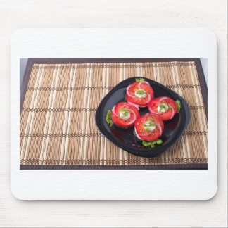 Black dish with sliced tomatoes and lettuce mouse pad
