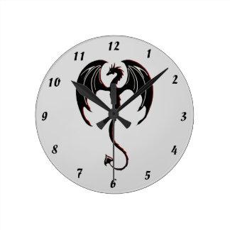 black dragon flying round clock