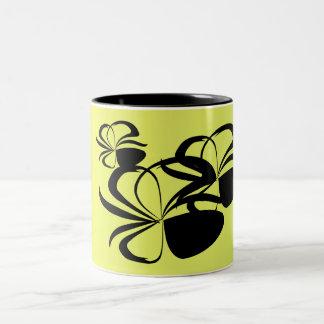 Black floral shapes on yellow Two-Tone coffee mug