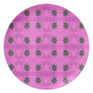 black flowers on pink plate