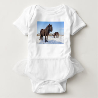 Black frisian horses in winter snow baby bodysuit