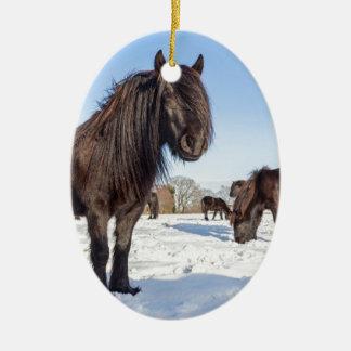 Black frisian horses in winter snow ceramic oval decoration