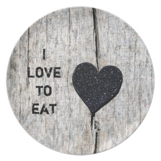 Black glitter heart on rustic wood plate
