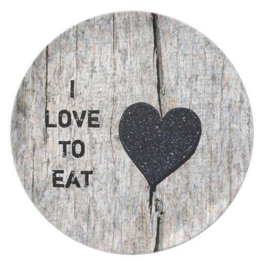 Black glitter heart on rustic wood plate