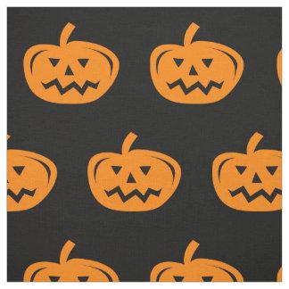 Black Halloween fabric with carved orange pumpkins